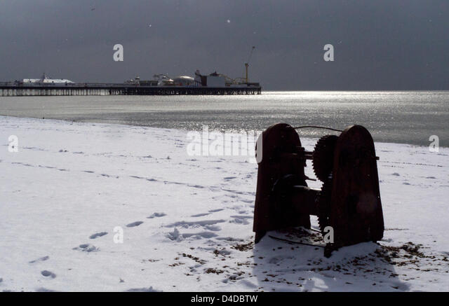 Brighton, East Sussex, UK. 12th March 2013. Brighton Pier. After a night of chaos on the roads caused by snow and - Stock Image