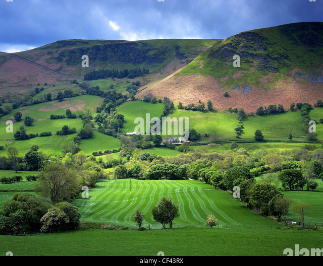 Looking across a lush fertile valley on a summer's day in Mid Wales. - Stock Image