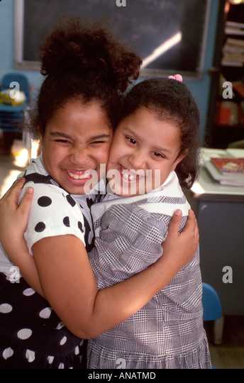 New Jersey Garfield Black girls hug students classmates friends - Stock Image