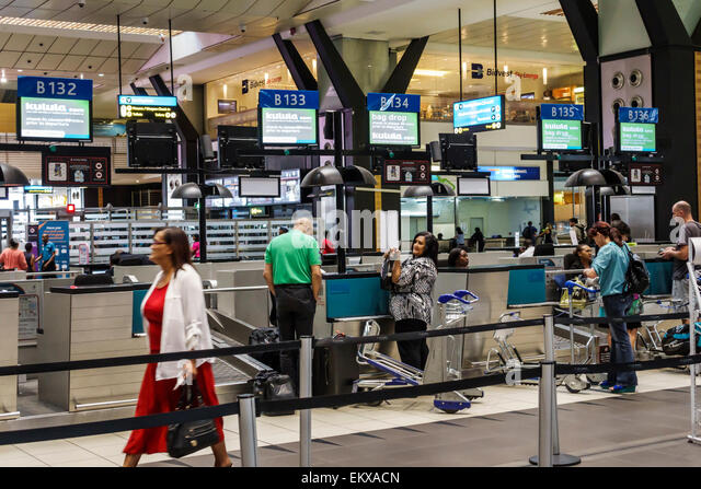 Johannesburg South Africa African O. R. Tambo International Airport inside terminal concourse ticket counter check - Stock Image