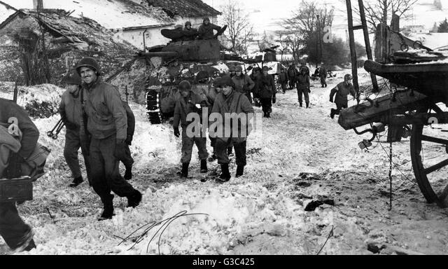 American soldiers assemble during the Battle of the Bulge, the German ...