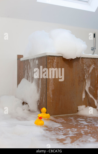 Bath tub overflowing - Stock Image