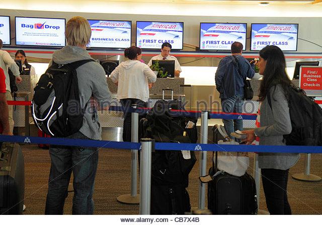 California San Francisco San Francisco International Airport SFO aviation terminal American Airlines ticket counter - Stock Image