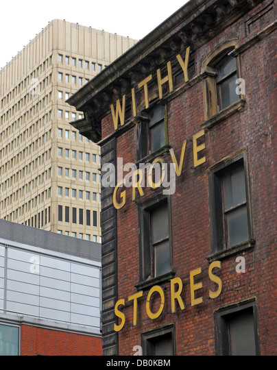 The old withy Grove Stores victorian building in Shudehill Manchester City Centre with the 1970s Arndale shopping - Stock Image