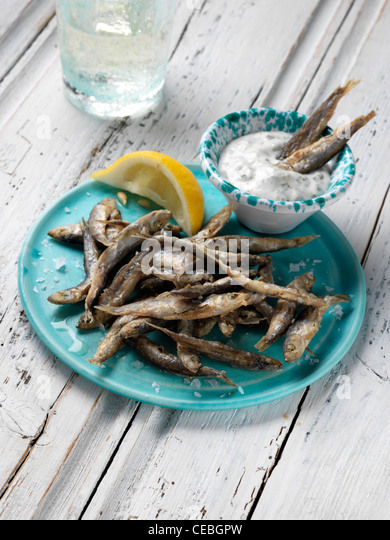 Deep fried seasoned whitebait - Stock Image