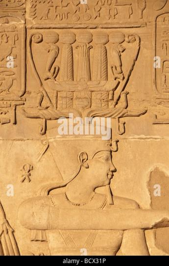 Egypt Kom Ombo temple wall pharaoh portrait wears crown beard indicating death - Stock Image