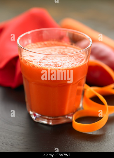 Red pepper,ginger and carrot smoothie - Stock Image