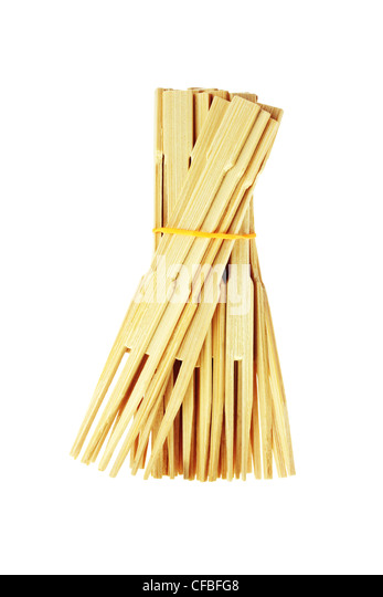 Bunch of Bamboo Food Skewers on White Background - Stock Image