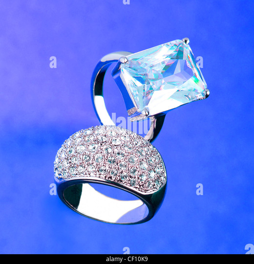 A still life shot of diamond engagement and wedding rings - Stock Image