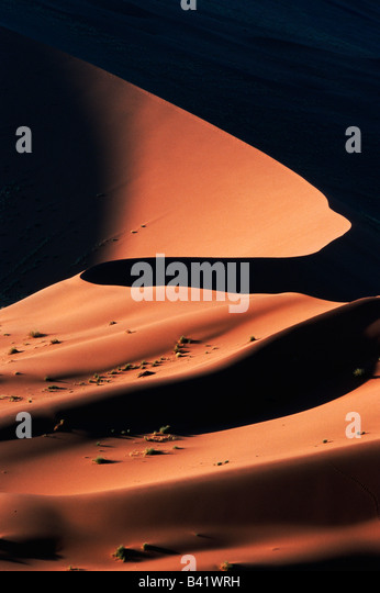 Sand dunes at last light Sossusvlei Namib Naukluft National Park Namibia Africa - Stock-Bilder