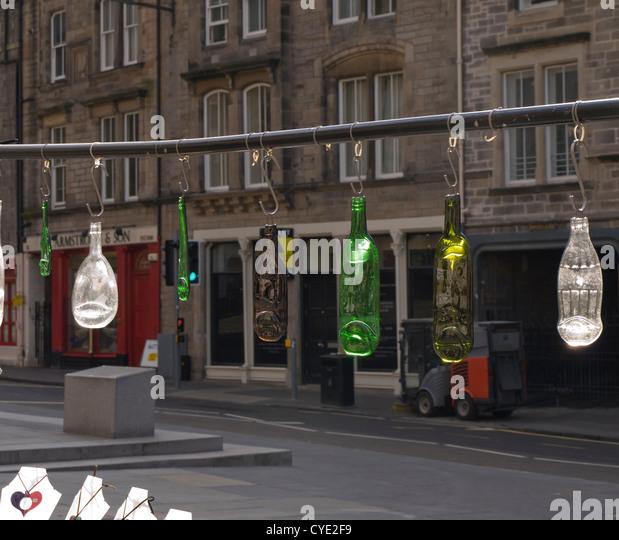 Flea market in Grassmarket Edinburgh Scotland, pendants from recycled bottles - Stock Image