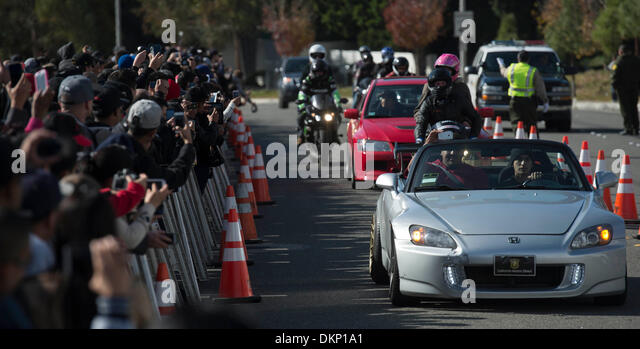 Los Angeles, USA. 8th Dec, 2013. Fans of actor Paul Walker take part in a car cruise at a memorial rally in Valencia, - Stock Image