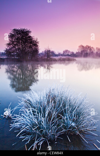 A frosty Cotswold winter sunrise on the River Thames at Lechlade, Gloucestershire, England, UK - Stock Image