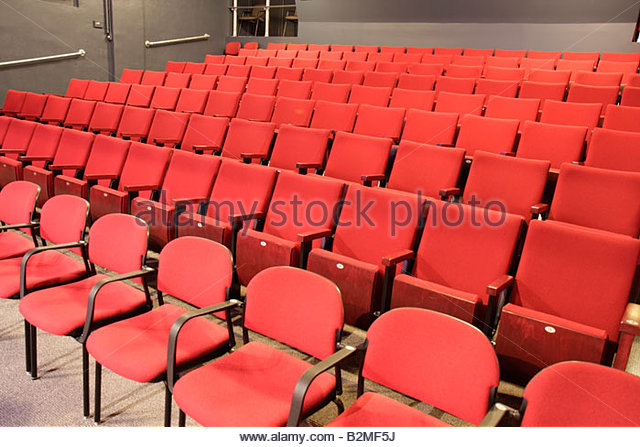 Indiana Valparaiso Chicago Street Theatre community playhouse chair seating red folding row empty pattern - Stock Image