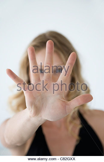 Woman,face obscured by hands. - Stock Image