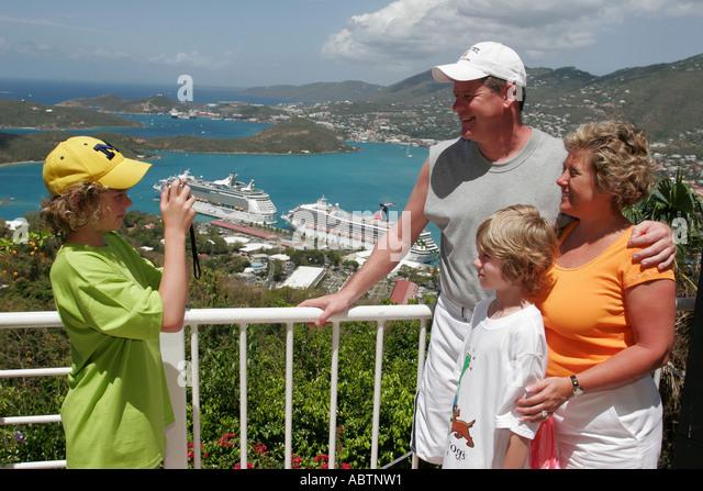 St. Thomas USVI Paradise Point family pose for photo Charlotte Amalie Harbor Caribbean Sea cruise ships - Stock Image