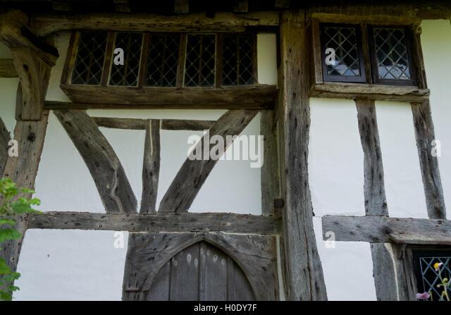 Timber framed building in England, United Kingdom. Oak wood structure with wattle and daub infill. Painted with - Stock Image