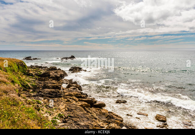 Late afternoon sun over the rocks near Plouhinec, Brittany, France - Stock Image