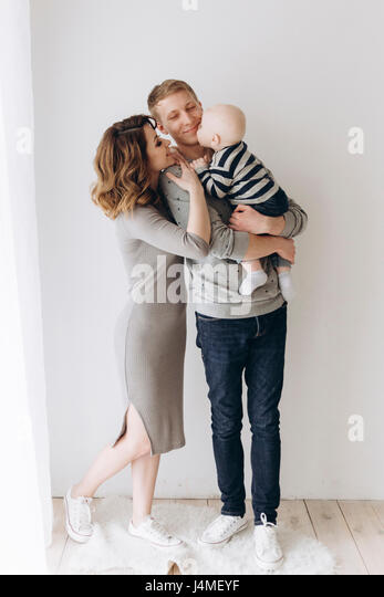 Caucasian mother and father admiring baby son - Stock-Bilder
