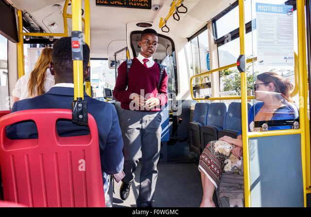 Cape Town South Africa African MyCiTi bus public transportation Black boy adolescent student school uniform riding - Stock Image