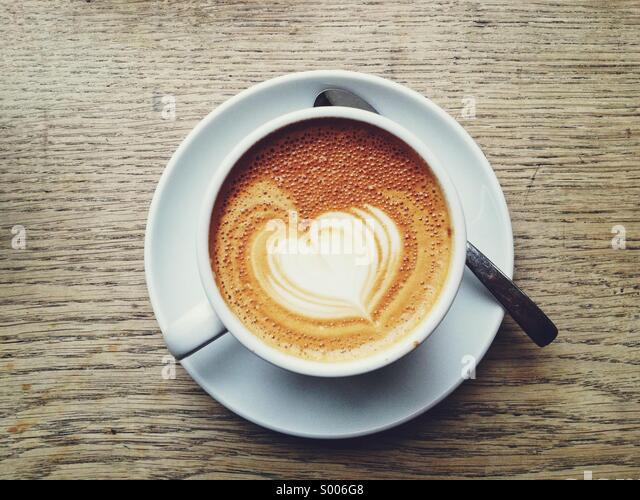 Heart shaped coffee art on a latte - Stock Image