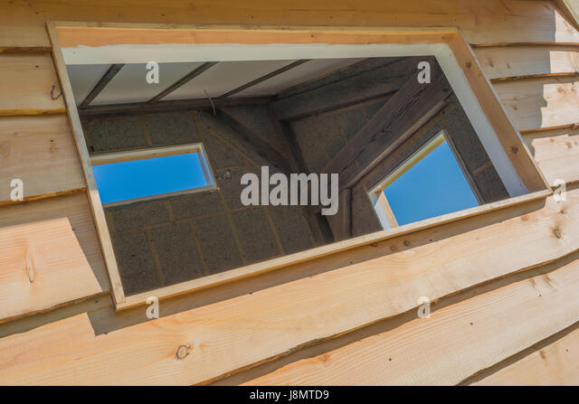 Three empty windows spaces in an outside office shed / building. - Stock Image