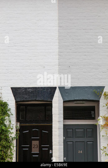 Contrasting wall paint colours of adjacent doorways. - Stock Image