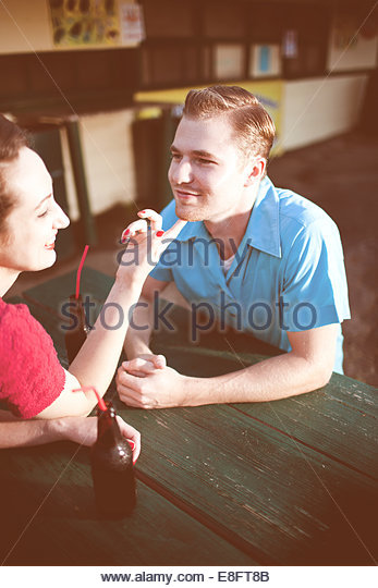 USA, Connecticut, Couple having drinks in front of drive-in - Stock-Bilder