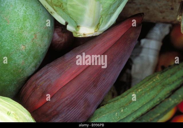 Banana flower and assorted vegetables, close-up - Stock Image
