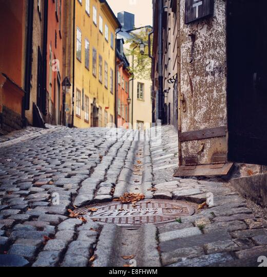 Sweden, Svealand, Stockholm,  Manhole cover in cobbled street - Stock Image