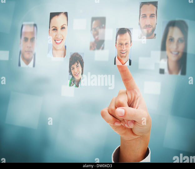 Female finger selecting profile picture - Stock Image