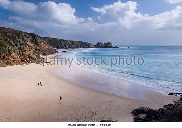 People on the beach at Porthcurno, West Cornwall, England, UK. - Stock Image