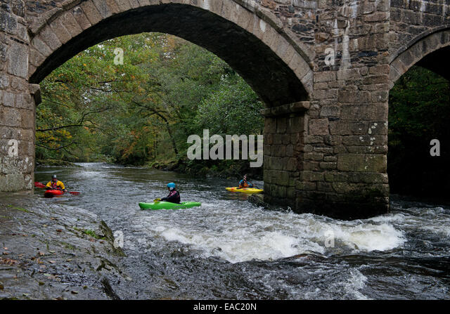 People canoeing near Newbridge or New Bridge on the River Dart in  Dartmoors National Park.South  Devon, England. - Stock Image