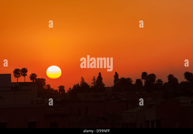 Sunset of the Place Djemaa el'Fna in Marrakesh. - Stock Image