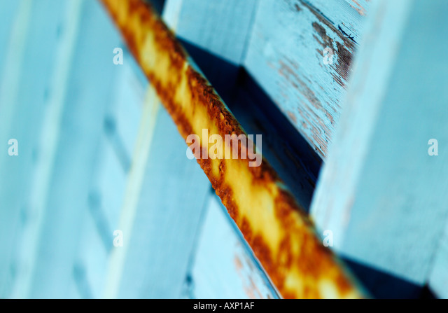Abstract view of a rusty bar on a beach hut - Stock-Bilder