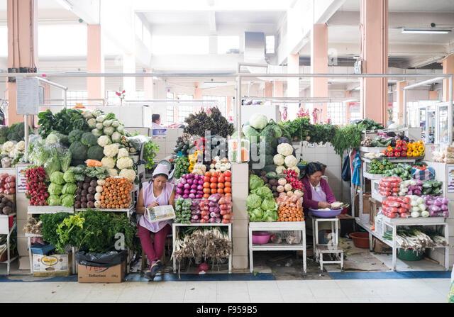Quito , Ecuador. The Mercado Central de Quito. Women selling fruit. - Stock Image
