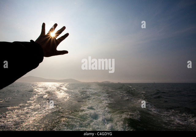 Sunlight through fingers - Stock Image