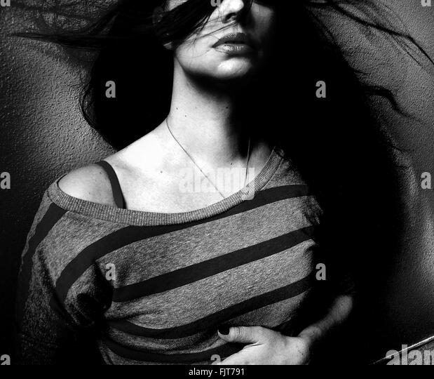 Midsection Of Beautiful Woman With Tousled Hair - Stock Image
