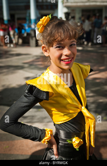 Girls getting ready for a performance in the streets of La Habana, Cuba, Caribbean. - Stock Image