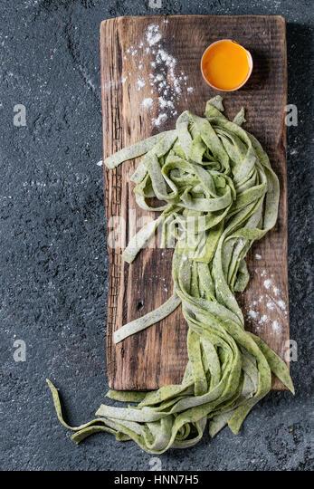 Fresh homemade green pasta tagliatelle - Stock Image