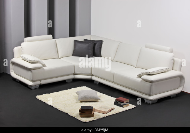 A modern minimalist living-room with furniture - Stock Image
