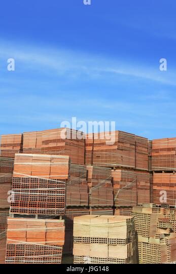 Stacked bricks on construction site stock photos stacked for Order of building a house