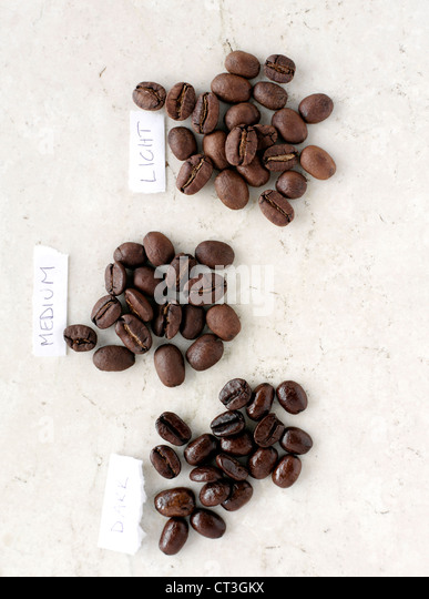 Piles of labeled coffee beans - Stock Image
