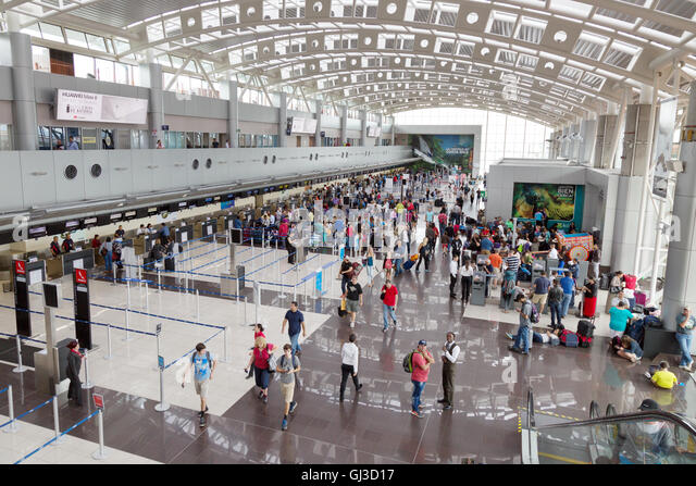 People in the baggage check in area, Juan Santamaría International Airport , San Jose, Costa Rica Central America - Stock Image