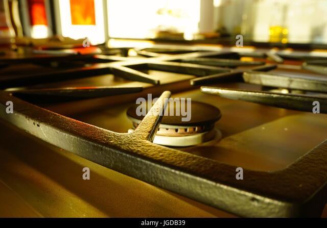 Close up of Black iron gas stove top in kitchen - Stock-Bilder
