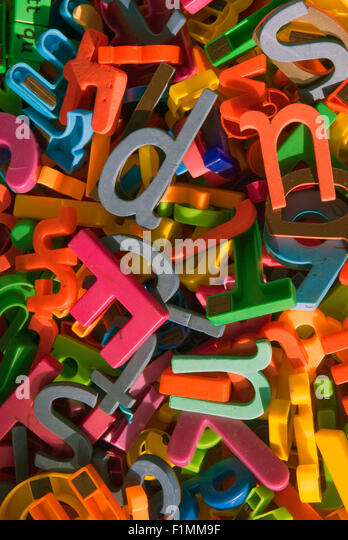 Assorted coloured letters as learning aids in primary school classroom, London, UK. - Stock Image