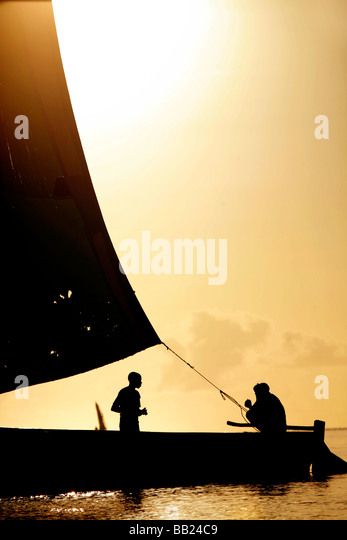 Dhow at sunset in the Indian Ocean off Vilanculos in Mozambique - Stock Image