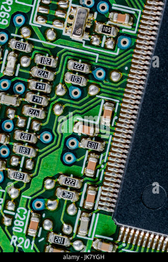 Surface mount technology (SMT) components on a green printed circuit board. Interconnected concept. - Stock Image