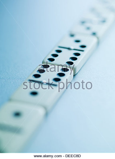 Dominoes laying in a row - Stock Image