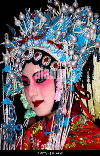 Chinese opera star in traditional costume and makeup. Beijing - Stock Image